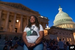 Rep. Cori Bush, D-Mo., speaks with reporters as she camps outside the U.S. Capitol, in Washington, Aug. 2, 2021.