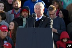 Sen. Roger Wicker, R-Miss., takes the stage during a rally in Tupelo, Miss., Nov. 26, 2018.