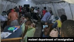 Malawi returnees screened at Mwanza border upon arrival from South Africa. (Courtesy: Pasqually Zulu/Immigration Departmentment)