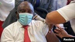 South African President Cyril Ramaphosa receives the Johnson and Johnson coronavirus disease (COVID-19) vaccination at the Khayelitsha Hospital near Cape Town, South Africa, Feb. 17, 2021.