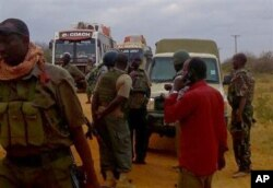 FILE - Kenya army soldiers patrol near attacked buses in Mandera, Kenya, July 1, 2016, after gunmen, thought to be from the al-Shabab group according to a Kenyan official, killed at least six people.