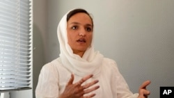 Zarifa Ghafari, former mayor of Maidan Shahr and Afghan women's rights activist, who arrived with her family in Cologne recently, speaks during an interview with the Associated Press at a hotel in Duesseldorf, Germany, Aug. 25, 2021.