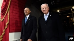 FILE - President Barack Obama and Vice President Joe Biden arrive for the Presidential Inauguration of Donald Trump at the U.S. Capitol in Washington.