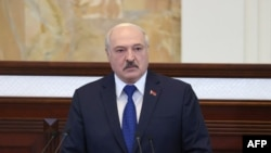 FILE - Belarusian President Alexander Lukashenko speaks during his meeting with parliamentarians, members of the Constitutional Commission and representatives of public administration bodies in Minsk, May 26, 2021.