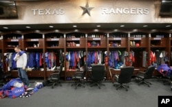FILE - Major U.S. sports leagues are closing access to locker rooms and clubhouses to all non-essential personnel.