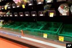 Empty shelves are seen in a supermarket in Milan, Feb. 23, 2020, as fears spread of rising numbers of coronavirus cases in Italy.