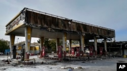 This photo released by the Iranian Students' News Agency, ISNA, shows a gas station that was burned during protests that followed authorities' decision to raise gasoline prices, in Tehran, Iran, Sunday, Nov. 17, 2019. Ayatollah Ali Khamenei, Iran's…