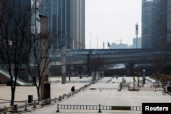 A man sits in a deserted shopping area in Changsha, Hunan province, China, as the country is hit by an outbreak of a new coronavirus, Jan. 29, 2020.