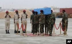 Members of a Somali military unit carry the body of the Mogadishu mayor Abdirahman Omar Osman for burial, in Mogadishu, Somalia, Aug. 4, 2019.