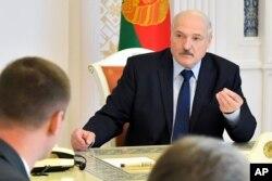 Belarusian President Alexander Lukashenko speaks at a meeting in Minsk, Belarus, Aug. 14, 2020.