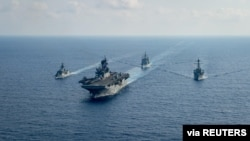 Royal Australian Navy guided-missile frigate HMAS Parramatta (L) sails with U.S. Navy Amphibious assault ship USS America, USS Bunker Hill and USS Barry in the South China Sea, April 18, 2020. (Credit: U.S. Navy)