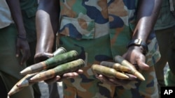FILE - A South Sudanese army commander holds ammunition captured from opposition fighters during clashes in Kuek, northern Upper Nile state, South Sudan, Aug. 19, 2017.