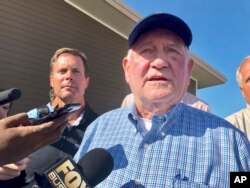 FILE - U.S. Agriculture Secretary Sonny Perdue speaks to reporters during a visit to Decatur, Ill., Aug. 28, 2019.