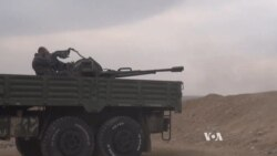 IS, Kurds Battle for Key Syrian Town