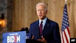 UMnu. Joe Biden speaks to local residents during a community event. (AP Photo/Charlie Neibergall)