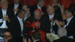 Prezident Obama və Mitt Romni eyni masa arxasında
