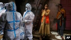 Health workers screen residents for COVID-19 symptoms at Dharavi, one of Asia's biggest slums, in Mumbai, India, Aug. 3, 2020. India is the third hardest-hit country by the pandemic in the world, after the United States and Brazil.