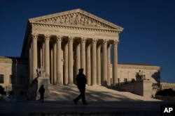 The Supreme Court is seen at sundown on the eve of Election Day, in Washington, Monday, Nov. 2, 2020.