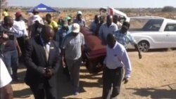 Mourners Gather at Burial of Wife, Mother of Two, Killed in Zimbabwe's Post-Election Violence