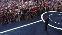 Obama y Clinton, un abrazo fraterno