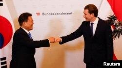 Austrian Chancellor Sebastian Kurz welcomes South Korea's President Moon Jae-in for a meeting in Vienna, Austria, June 14, 2021.