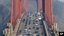 FILE - In this Sept. 19, 2013 file photo, automobile traffic flows over the Golden Gate Bridge in San Francisco. Doctors and California officials will be among those weighing in on the Trump administration's proposal to roll back car-mileage…