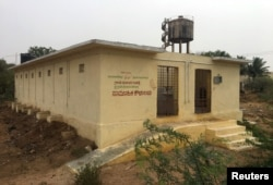 """FILE - A public toilet built as part of the """"Clean India"""" mission, is pictured in Guladahalli village in the southern state of Karnataka, India, April 30, 2019."""