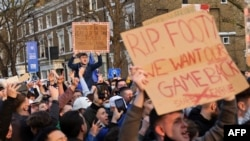 Football supporters demonstrate against the proposed European Super League outside of Stamford Bridge football stadium in London, April 20, 2021.