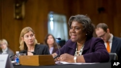 FILE - Assistant Secretary of State for African Affairs Linda Thomas-Greenfield, right, testifies during a Senate Foreign Relations Committee hearing on Capitol Hill in Washington, Jan. 9, 2014.