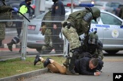 Police detain a man during an opposition rally to protest the official presidential election results in Minsk, Belarus, Nov. 1, 2020.