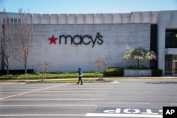 FILE - The Macy's store at the popular Tyson's Corner Center sits closed Monday, March 30, 2020, in McLean, Va., a Washington, D.C., suburb.