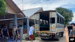 In this photo released by the San Sai District Administrative Office, journalists working for Democratic Voice of Burma, prepare to get into a van after being arrested at San Sai District in Chiang Mai province north of Thailand Sunday, May 9, 2021…