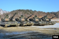 FILE - M1-A2SEP Abrams tanks participating in a platoon qualifying exercise near the DMZ. (Photo: VOA / Steve Herman)