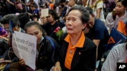 A supporter of Thailand's Future Forward Party cries as they watch a live television broadcast of a court verdict at their party's headquarters in Bangkok, Thailand, Friday, Feb. 21, 2020. Thailand's Constitutional Court on Friday ordered the…