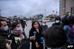 Human Rights Watch Turkey director Emma Sinclair-Webb, center, talks to the press on Dec. 18, 2020 in Istanbul after a hearing in the trial of jailed Turkish philanthropist Osman Kavala, on charges connected with a failed coup in 2016.